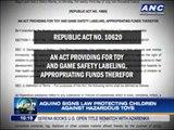Aquino signs law protecting children against hazardous toys