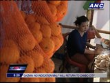 Tacloban orphan survives by selling candies, cigarettes