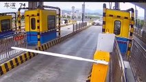 Car flips 360 degrees after smashing into toll gate in China's Yiwu