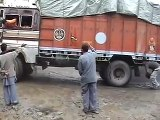 truck taking a corner on a bad road ,  excellent driving skills