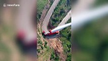 Truck transports 70-metre-long wind turbine blade on winding road in China