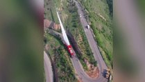 Chinese truck makes dramatic delivery of huge wind turbine blade