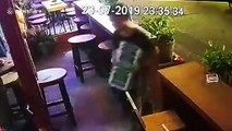 CCTV captures theif 'stealing cash' from British tourist's bag as he plays pool in Thailand