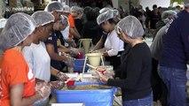 Aid organisation prepares boxes for hurricane-ravaged Bahamas