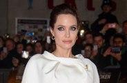 Angelina Jolie trains with kids