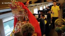 Statue of Chinese sea goddess travels on bullet train with real ticket