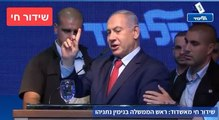 Prime Minister Benjamin Netanyahu steps off stage as rocket sirens sound in Ashdod.
