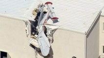 Un avion s'écrase contre un bâtiment, les deux passagers sains et saufs