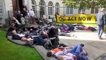 Extinction Rebellion protesters staging a 'die-in' outside Leeds Civic Hall.