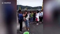 Teacher uses towel to wipe off students' makeup at school gate in China
