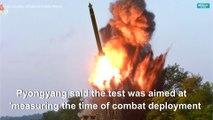 N.Korea releases photos of 'super-large' rocket launcher tests