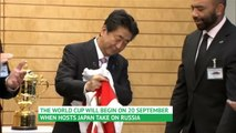 Japan PM greets World Rugby execs