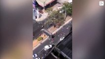Fans of the same Colombian soccer team fight with machetes on the street