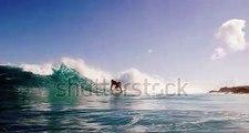 @ ノアパブリッシメント stock-footage-surfer-riding-and-turning-with-spray-on-blue-ocean-wave-surfing-ocean-lifestyle-extreme-sports