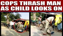 Cops thrash man for violating traffic rules as child looks on | Oneindia News