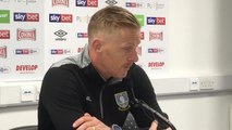 Sheffield Wednesday boss Garry Monk has hailed the effort of his strikers after his side's 2-0 win over Huddersfield Town.
