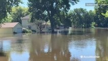 Neighborhood left underwater following river flooding