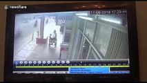 CCTV footage shows thief snatching phone from disabled man's hands in Indonesia