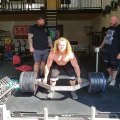 Bodybuilder Deadlifts Heavy Weights on Trap Bar
