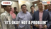 Not a problem, says Ku Nan when surrounded by cameras