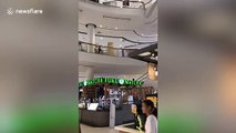 Dramatic moment shopping mall roof collapses during rain storm in Bangkok