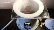 Ukrainian scientist makes bottle of Coca-Cola bubble over using vacuum