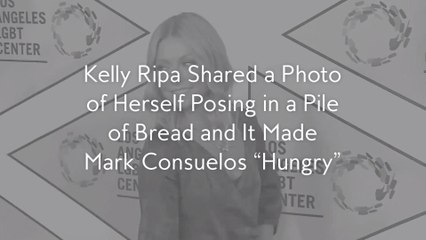 """Kelly Ripa Shared a Photo of Herself Posing in a Pile of Bread and It Made Mark Consuelos """"Hungry"""""""