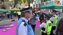 Police in London arrest Extinction Rebellion protesters reciting prayers