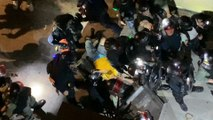 Hong Kong police deny beating protester, saying officers kicked a 'yellow object'