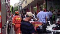 Firemen rescue girl hanging from seventh-floor window in eastern China