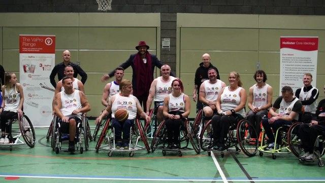 Tyson Fury presenting kit to wheelchair basketball team