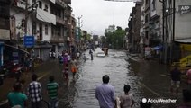 Floodwaters sweep through city after days of monsoon rain