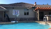 Guy Does Series of Creative Slam Dunks in Swimming Pool