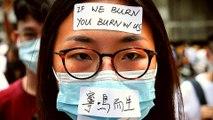 Hong Kong moves to ban face masks as protests continue