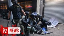 Arrests as mask ban fails to quell Hong Kong protests