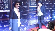 Ranveer Singh attends Elle Beauty Awards in black suit,hat & cane;Watch video | FilmiBeat