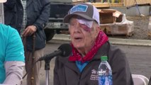 Jimmy Carter helps build homes despite suffering a fall