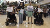 Hong Kong protesters rally against arrests of five mall staff after denying police entry