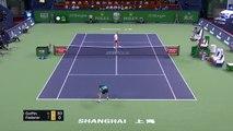 Federer holds off Goffin in Shanghai thriller