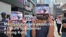 Manifestation pro-démocratie à l'heure du déjeuner dans le centre de Hong Kong