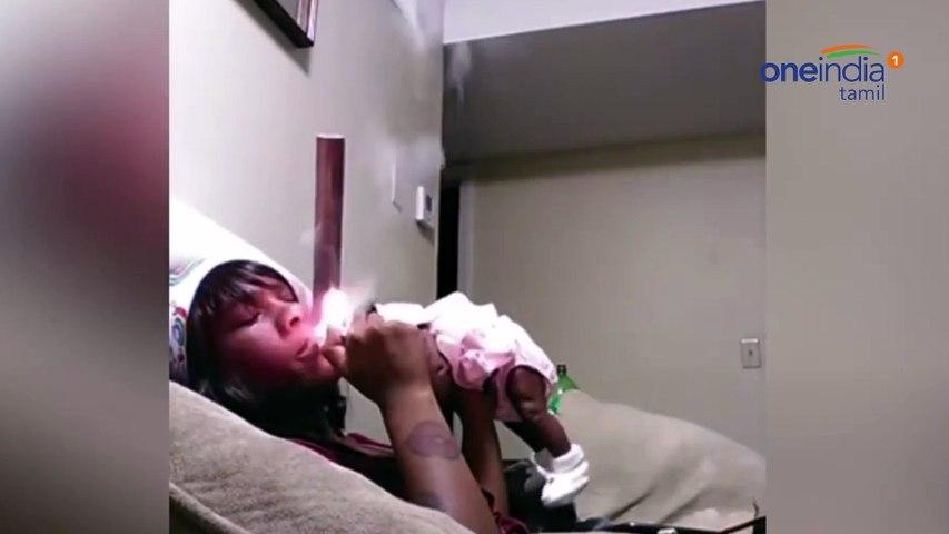 Shocking Video : Moment cruel mum tosses newborn with one hand while smoking