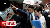 Hong Kong policy address halted after heckling