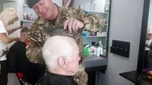 Veteran Ron Eve receives a free haircut barber Ronnie Eve ahead of Rememberance Day