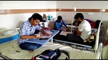 Student doctors infected with dengue take medical exam with drips in their hands at hospital in Jamnagar, India