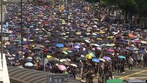 Hong Kong police and protesters exchange tear gas and petrol bombs
