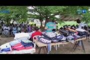 RTG/Remise de kits scolaires aux enfants des personnes handicapées vivant au quartier Pk12 par le Rotary Club Libreville Komo