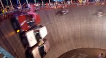 Stuntmen Perform Dangerous Trick With Bike And Car Inside Well-Shaped Amphitheatre