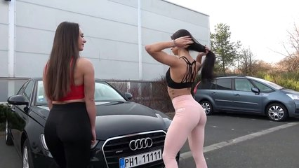 Sexy gym fitness girls armrestling in public