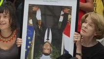Appeals begin for G7 protesters accused of stealing Macron portraits