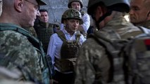 Ukraine troop withdrawal sparks hopes for revived peace process